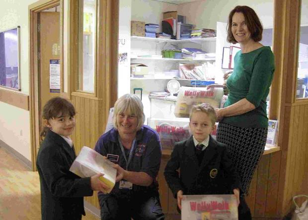 Salisbury Journal: Children from Forres Sandle Manor hand over their shoeboxes at Salisbury D