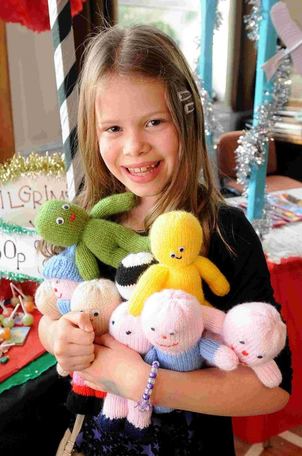 Alice with some lucky dip dolls. To see lots more photos from this event click 'Buy this photo'.