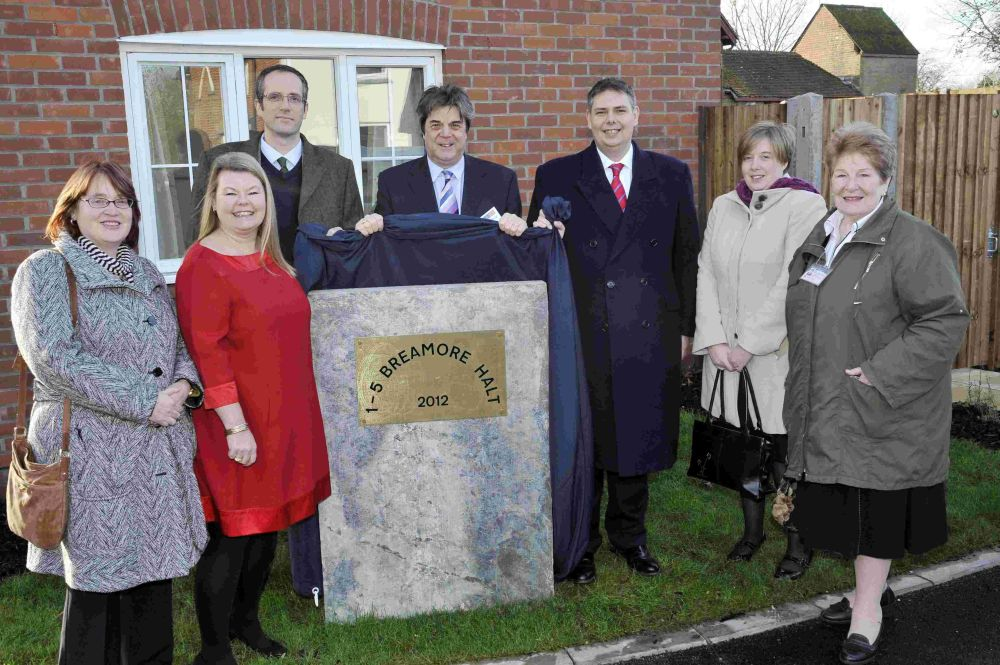 Councillors Jill Cleary and Edward Heron unveil the plaque at the new Breamore Halt homes. Picture: Nick Johnson