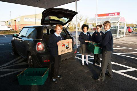 Catherine and her friends at Tesco to pick up her prize