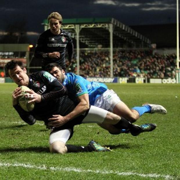Matt Smith, centre left, scores Leicester's final try to make sure of their victory