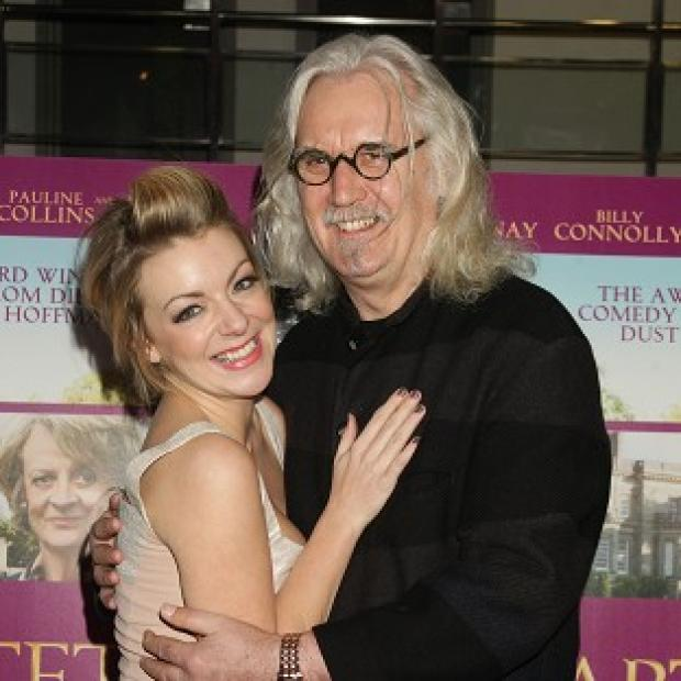 Billy Connolly and Sheridan Smith arrive for the charity gala screening of Quartet