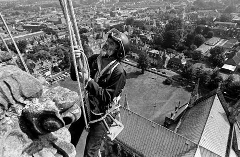 Roy Spring climbing the cathedral during his time as clerk of works