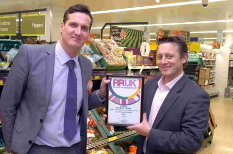 Will Clark (right), of Rainbow Rooms UK, presents the award to Tesco Metro manager John Gibney