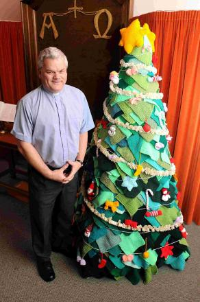 Rev John Scrivens with the knitted christmas tree at Fordingbridge Methodist Church