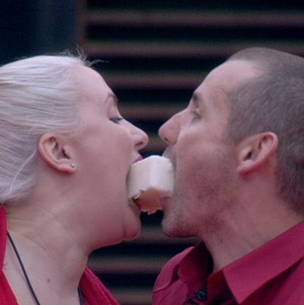 Claire Richards and Ryan Maloney pass the lard during their task