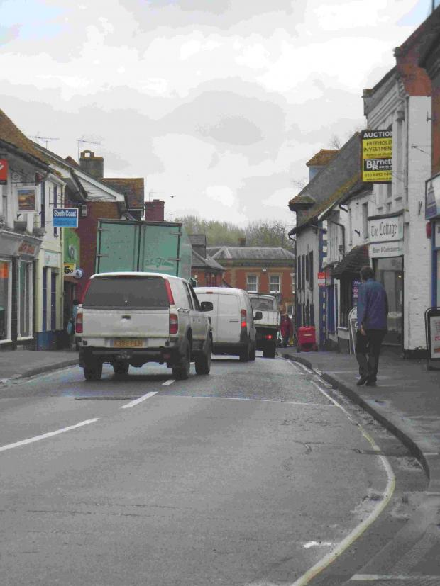 Traffic builds up after a lorry parks to make a delivery in Fordingbridge.