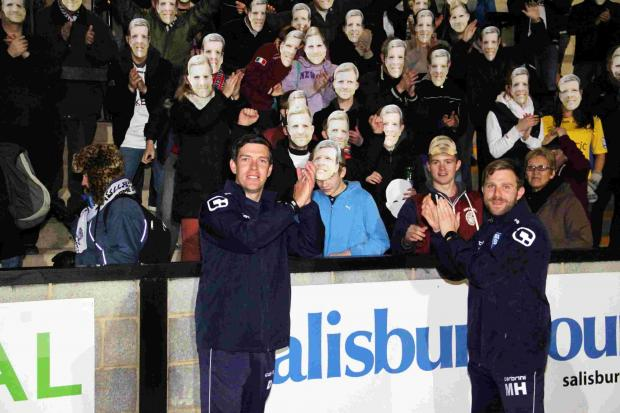 Salisbury Journal: Darrell Clarke and Mikey Harris celebrate with some passionate City fans: Picture by Simon Ward.