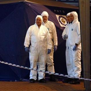 Forensic experts at the scene on Union Street in Birmingham city centre after two men were stabbed to death