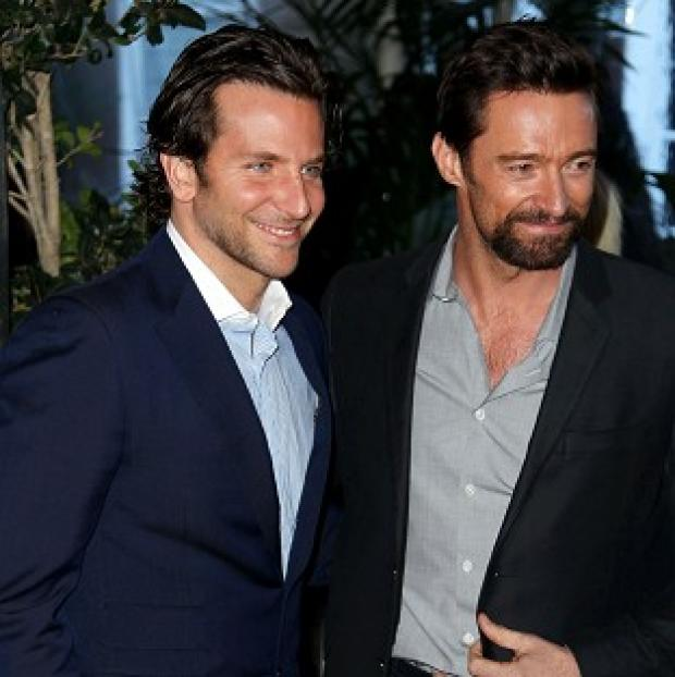 Bradley Cooper, left, and Hugh Jackman at the Bafta Awards Season Tea Party in Los Angeles (Matt Sayles/Invision/AP)