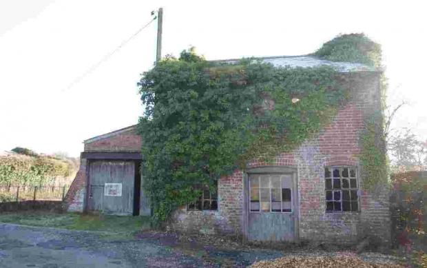 The former Environment Agency workshop and two-storey cottage-style building on the south side of the River Avon at East Mills Depot, Southampton Road, Fordingbridge.