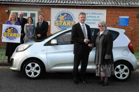 Stars Appeal raffle winner presented with car