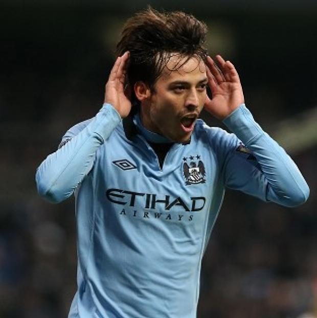 David Silva scored a goal in each half as Manchester City defeated Fulham