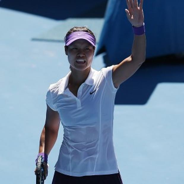 Li Na waves to the Melbourne crowd after defeating Maria Sharapova in their semi-final clash (AP)