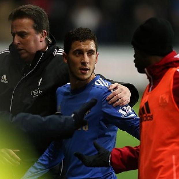 Eden Hazard, centre, leaves the pitch after being sent off against Swansea