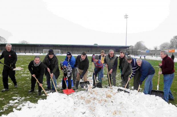 Fans helped clear the snow from the early hours on Saturday morning.