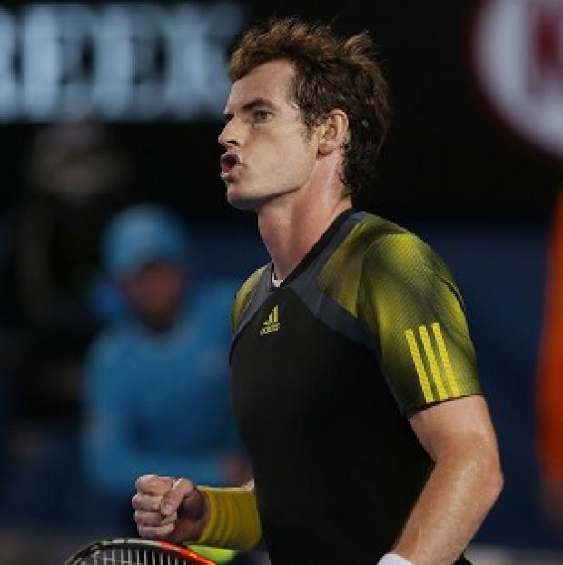 Andy Murray, pictured, expresses his delight after winning the first set against Novak Djokovic (AP)