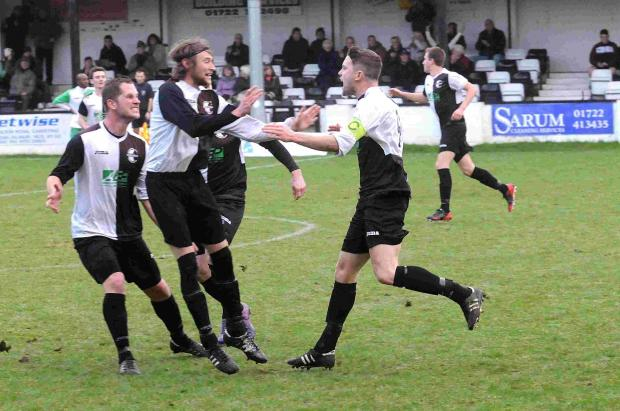 Bemerton skipper Jack Slade celebrates with his his teammates after scoring the opener.