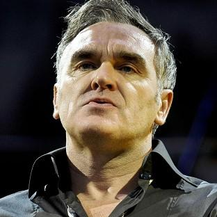 Morrissey has postponed a series of US concerts due to a bleeding ulcer