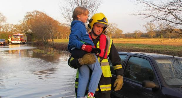 Girl, 10, rescued from flooded car