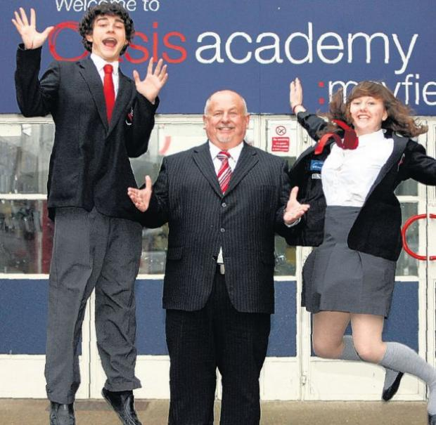 SUCCESS: Mr Toland celebrating school success last year with pupils Dean Beattie and Katie Downer.