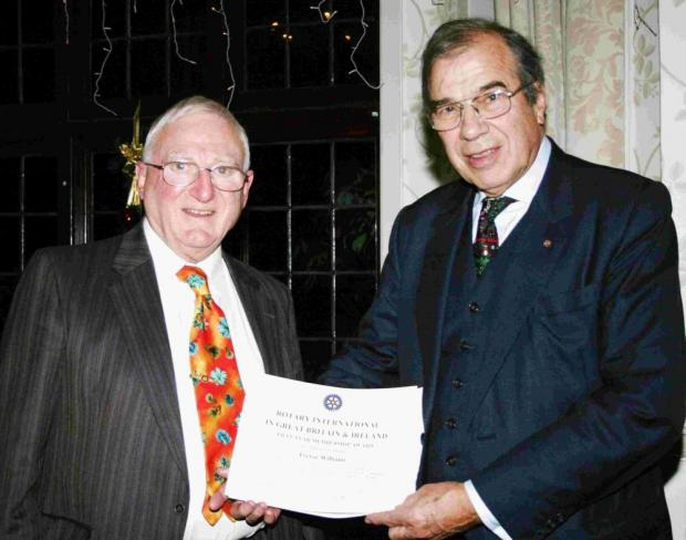 Trevor Williams receives a certificate from Ringwood Rotary Club president Geoffrey Ridgway in recognition of his active support in hundreds of projects during the 50 years he has been a member.