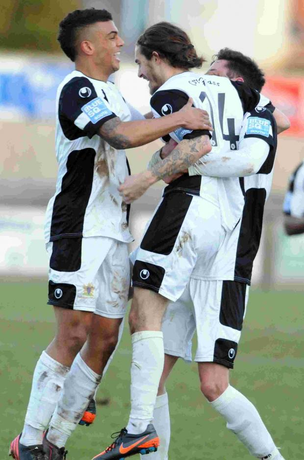 CAPTION: Rob Sinclair celebrates his goal for Salisbury on Saturday