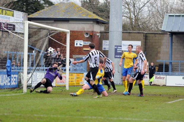 Salisbury City fail to clear, as Jake Smeeton scores the opener.