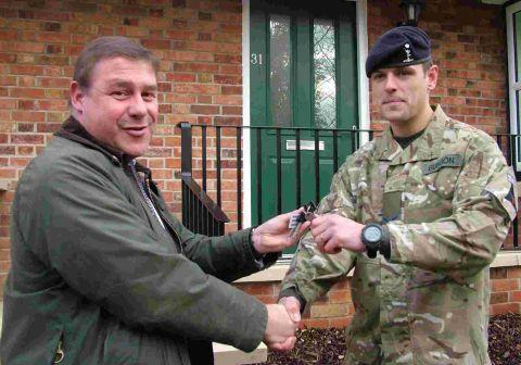 Mark Francois MP hands keys to L/Cpl Burgon outside his new quarters at the Canadian Estate in Bulford.