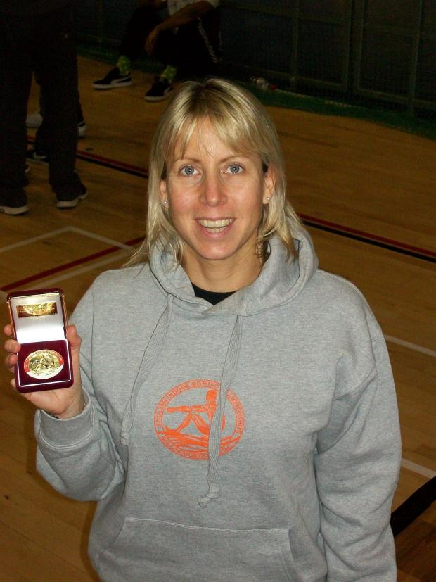 Susan, pitcured, shows one of her gold medals