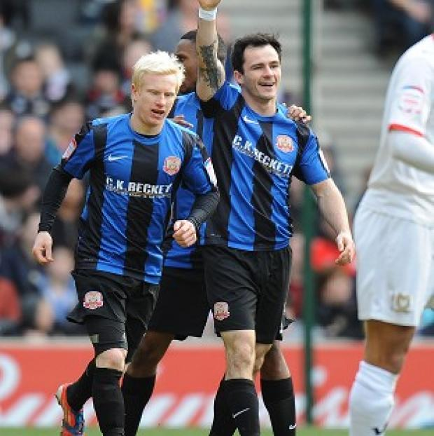 Chris Dagnall, right, bagged a brace for Barnsley