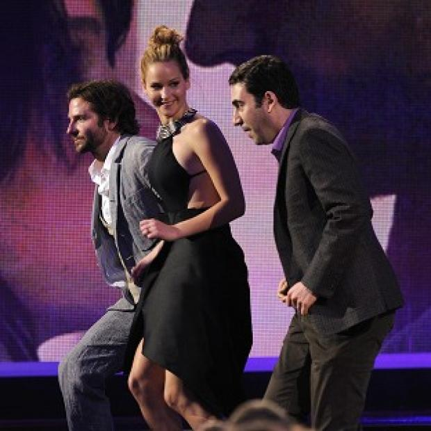 Bradley Cooper, Jennifer Lawrence and producer Jonathan Gordon accept the best feature award for Silver Linings Playbook (Chris Pizzello/Invision/AP)