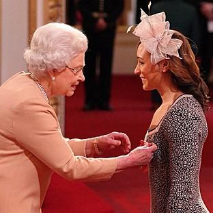 Jessica Ennis, right, is awarded her CBE medal from Queen Elizabeth II at Buckingham Palace