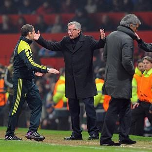 Sir Alex Ferguson, centre, did not attend the post-match press conference