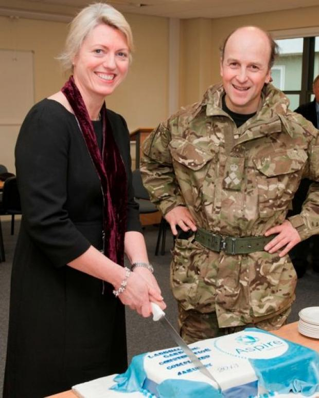 Brig Piers Hankinson celebrates the completion of construction at Larkhill Garrison with Aspire Defence Services Ltd's Garrison facilities director Nicola Patterson.