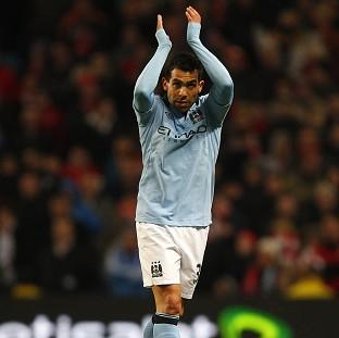 Ex-Manchester United striker Carlos Tevez helped fire Manchester City into the semi-finals
