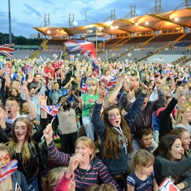 Fans watch Jessica Ennis win the 800 metres in the London 2012 Heptathlon confirming a gold in the event, on the big screen at the Don Valley Stadium.