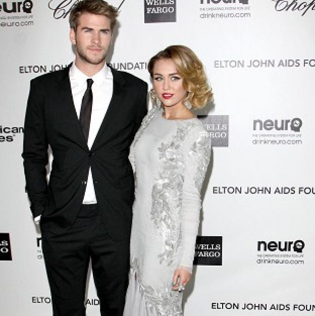 Liam Hemsworth and Miley Cyrus appear to be spending time apart