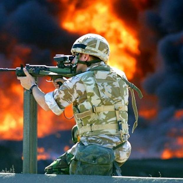 A member of the British Desert Rats during fighting on the outskirts of the Iraqi city of Basra