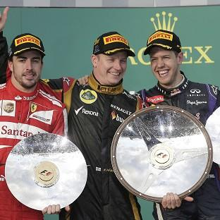 Kimi Raikkonen, centre, celebrates his victory in Melbourne