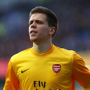 Wojciech Szczesny, pictured, insists he 'loves' Arsenal after his father criticised them