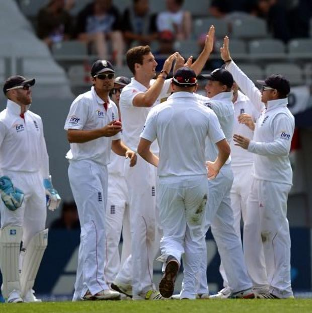 Steven Finn, centre, took the only wicket as New Zealand were 250-1 at stumps on day one of the third Test