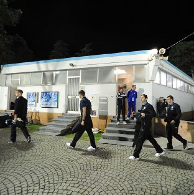 England's players arrive at the stadium before their World Cup qualifier with San Marino