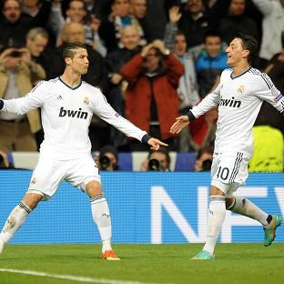Cristiano Ronaldo, left, and Mesut Ozil celebrate after the Portuguese opened the scoring