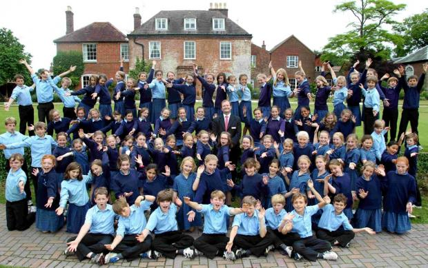 Salisbury Journal: Twyford School pupils and headmaster Dr Steve Bailey celebrate the school's inspection results