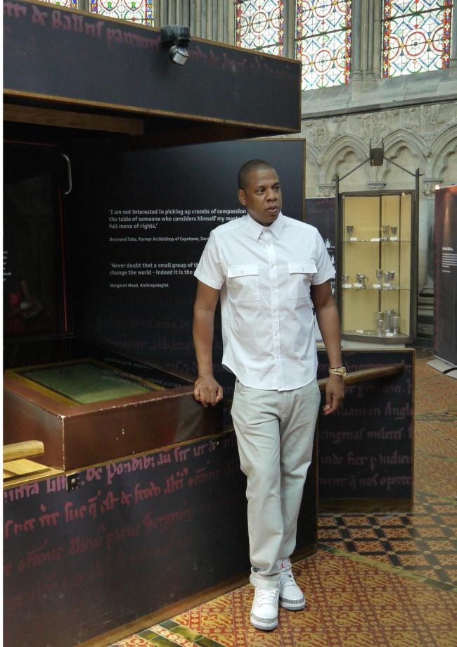 Jay-Z with the 1215 Magna Carta at Salisbury Cathedral.