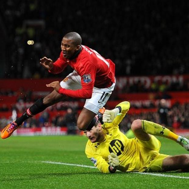 Salisbury Journal: Ashley Young was injured after going to ground under the challenge of Hugo Lloris
