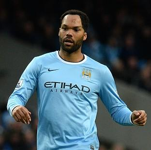 Salisbury Journal: Manuel Pellegrini believes Joleon Lescott, pictured, still has a role to play for Man City