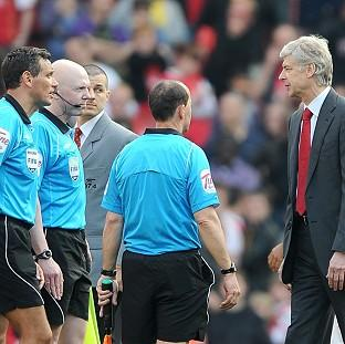Arsene Wenger, right, has backed former FA chairman David Bernstein's comments