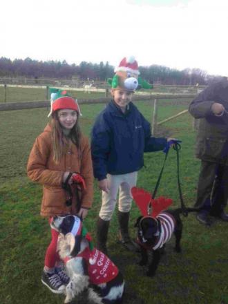 Imogen Dive and Zoe Peters, the 1st and 2nd place winners in the fancy dress class and the entrants of the Dog The Judge Would Most Like To Take Home class with judge Caroline Spencer, canine behaviour specialist and owner of Pure Dog Listeners